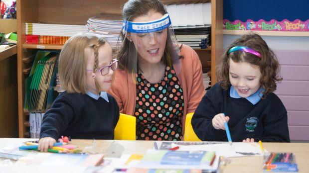 At St Hugh's were teacher Jacinta Green with new pupils Keva (left) and Emily. Photograph: Brian Farrell/The Irish Times