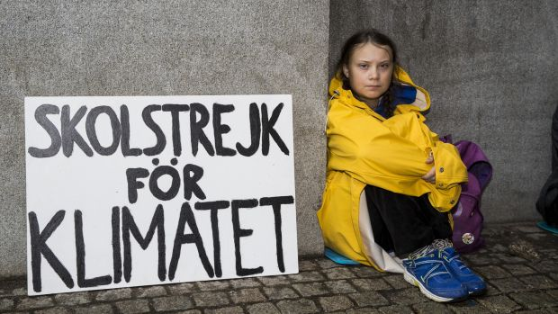 August 2018: Greta Thunberg (then 15) leads a school strike outside the Swedish parliament building in Stockholm to raises awareness for climate change. Photograph: Michael Campanella/Getty Images