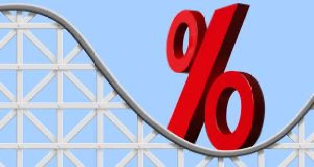 A large red percentage sign sits on a roller coaster symbolising the ups and downs of interest rate directions.