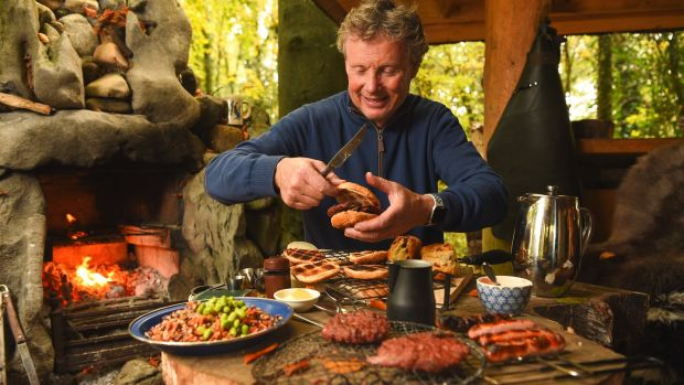 Derek McCarthy from Irish Hide Designs prepares a meal from his wood cabin in Lisnagry, Co Limerick. Photograph: Diarmuid Greene