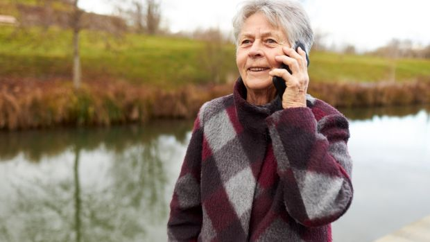 Chatting on the phone is a great way to brighten up your walk. Photograph: iStock