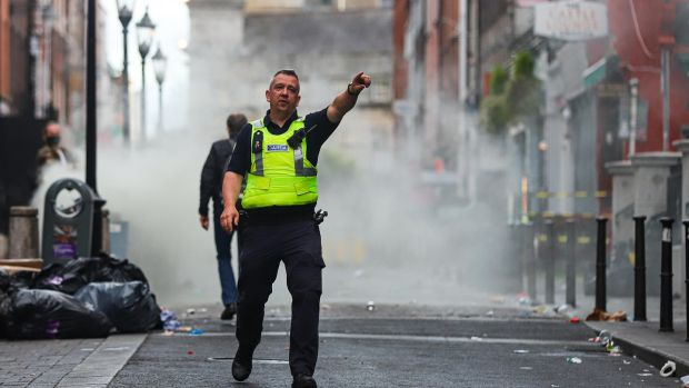 Gardaí clear South William Street in Dublin on Saturday evening after a fire broke out in a bin. Photograph: Damien Storan