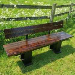 Long lasting dark wood bench with back