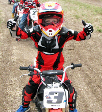 Motocross child riding Honda CRF 50
