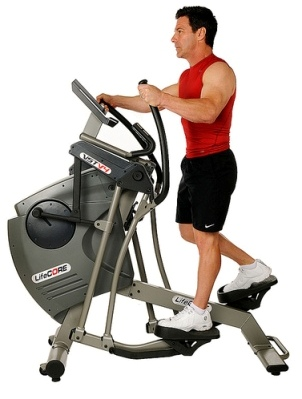 Man using an elliptical trainer