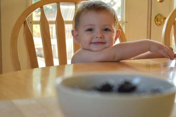 Sawyer helping me make this healthy blackberry frozen yogurt recipe with my Cuisinart