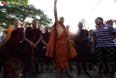 Demonstrators, including Buddhist monks, gather outside Aung San Suu Kyi's home in Rangoon on Sunday to protest the sentencing to death of two Burmese migrants for murder in Thailand. (Photo: JPaing / The Irrawaddy)