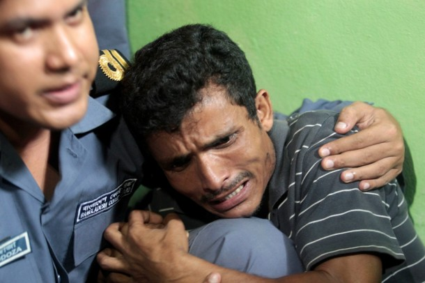 A distraught Rohingya man is comforted by a Bangladeshi border guard. (Photo: Reuters)