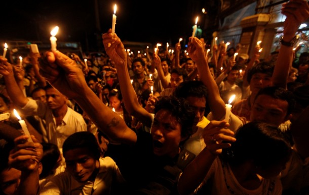 Demonstrators hold a candle-lit protest against power shortages by Rangoon's Sule Pagoda in May. (Photo: Reuters)