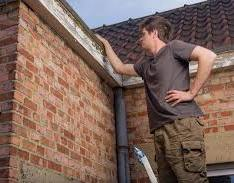 man doing Roof Inspection