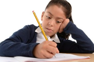 http://www.dreamstime.com/stock-images-hispanic-female-child-writing-carefully-homework-pencil-concentrated-face-sweet-little-children-education-back-to-image44238274