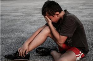 a boy in pain