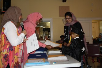 Family receiving certificate of completion