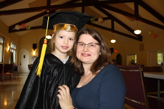 Mom and daughter at graduation