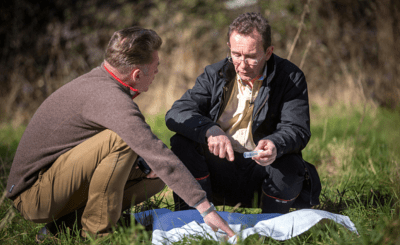 Chris Packham and Professor Richard Wall search for ticks that may have infected dogs in the Harlow area (courtesy of swns.com)