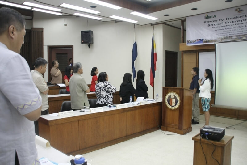 Forum participants sing the Philippine National Anthem.