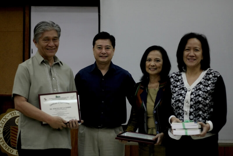 DA Representative Ed  dela Torre receives a certificate of appreciation as resource speaker during the dialogue from FSSI's Jay Lacsamana, ISEA's Lisa Dacanay, and Rep. Tanada's CoS Jessica Cantos.