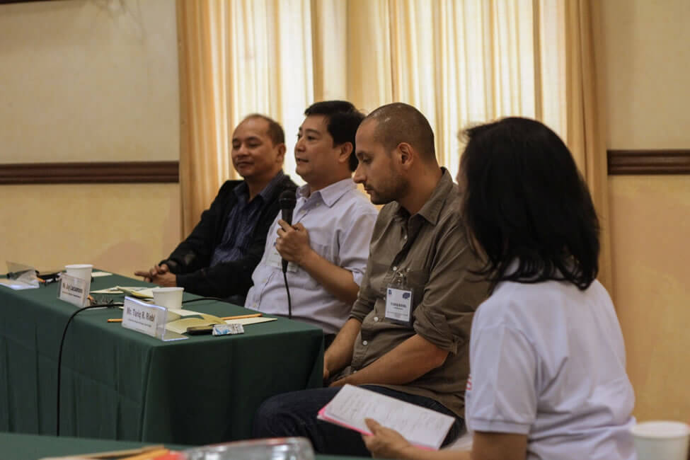 "Mr. Jay Lacsamana, Executive Director of the Foundation for a Sustainable Society, Inc. (FSSI) explains FSSI's Triple Bottom Line Local Economic Development framework during the ""Panel Discussion on Reconstruction Initiative through Social Enterprise (RISE) with Social Enterprise Resource Institutions"".  With him in the panel are Mr. Ricardo ""Bong"" Soto, Jr., Disaster Risk Reduction Program Coordinator of Peace and Equity Foundation (extreme left) and Mr. Tariq R. Riebl, Humanitarian Response Manager of Oxfam."