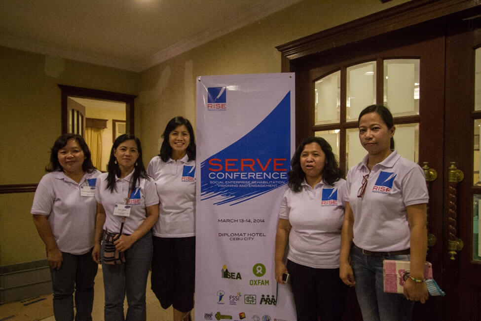 SERVE Conference Secretariat members Ms. Donna Nobleza, Ms. Line Mamburam, Ms. Teresa Ruelas and Ms. Silay Ramos take a break with Ms. Geraldine Labradores, representative of the World Fair Trade Organization-Philippines to the Organizing Committee.