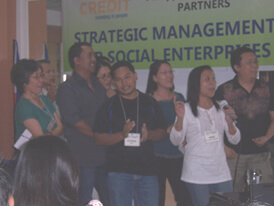 Manager-participants from Don Bosco Foundation for Sustainable Development, Upland Marketing Foundation Inc, Davao Provinces Rural Development Institute Inc and Oikocredit-Philippines present their social marketing workshop output in a song.