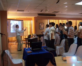 """Participants sing """"Man in the Mirror""""  to begin the Social Marketing Voluntary Change session."""