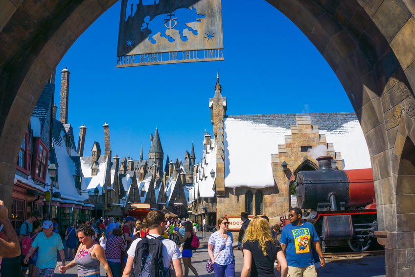 Orlando, Florida, USA - May 09, 2018: People going at The Wizarding World of Harry Potter in Islands of Adventure, Universal in Orlando, Florida on May 09, 2018