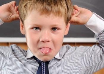 Funny preschool aged boy fooling in classroom; Shutterstock ID 109983830; PO: TODAY.com