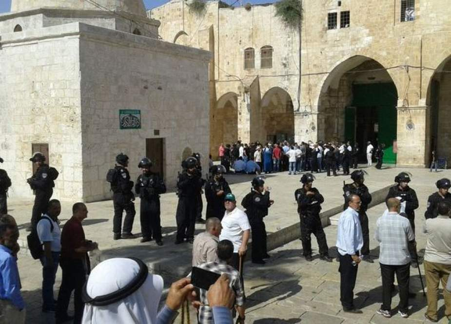 Zionist Occupation Troops banning Palestinians from entering Al-Aqsa Mosque.jpg