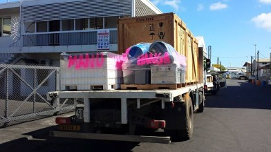 Buckets and equipment being trucked from warehouse to wharf