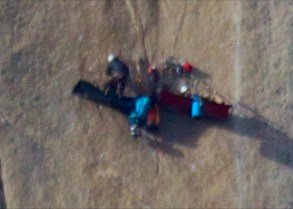 Two little cots attached to the sheer rock face … Yikes!
