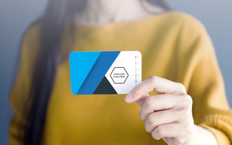 A Woman Holding A Business Card