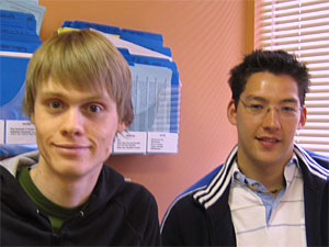 Two young males sitting in an exam room