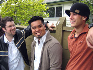 three young men standing outside discussing a vasectomy procedure