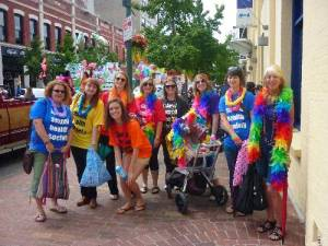 Photograph of ISH staff and volunteers dressed in rainbow colours for the 2011 Victoria Pride parade