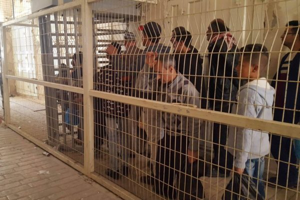 Palestinian residents are made to wait outside the Ibrahimi Mosque checkpoint following its reopening on Friday.