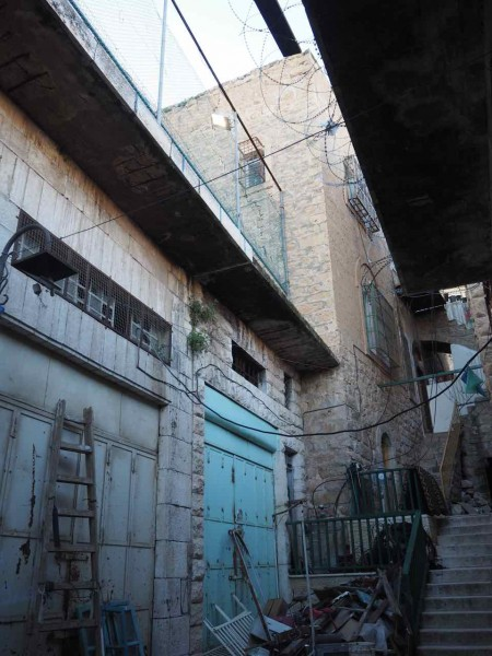 The entrance to the family home, located between Shuhada Street and Shalallah Street. To the left of the house is the playground for the children of Israeli settlers.