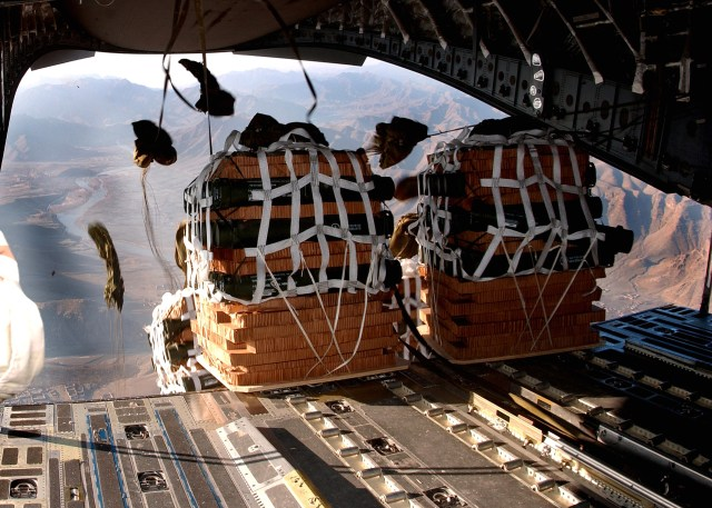 Parachutes begin to open on supply pallets being airdropped from a C-17 Globemaster III to servicemembers Jan. 2 at a remote camp in Afghanistan. The aircraft is from a desert air base in Southwest Asia. (U.S. Air Force photo/Senior Airman Ricky J. Best)