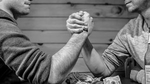 picture of men arm wrestling