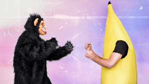 picture of a monkey and guy in banana suit fighting
