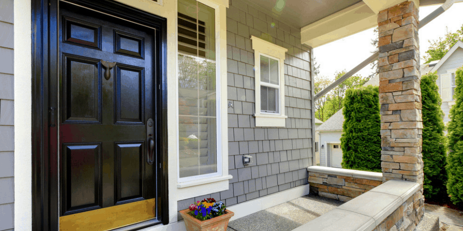 picture of the front door of a house with electronic lock box
