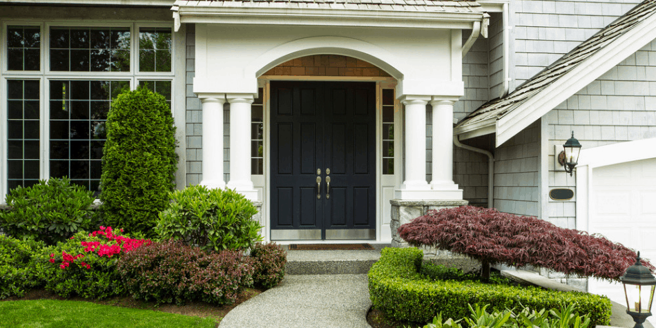 picture of the front of a house with a lock box