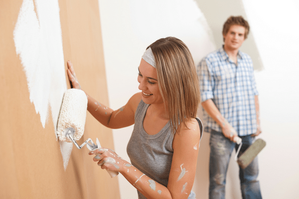picture of people priming and painting walls