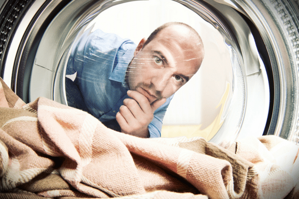 picture of a man doing laundry