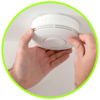 picture of a man installing a co detector