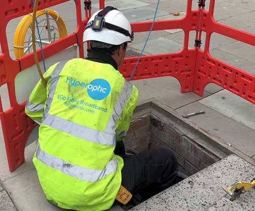 hyperoptic engineer over manhole