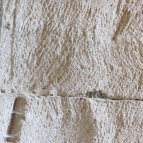 Stone cutter contour and fault in wall of the cave