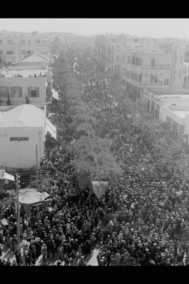 "Masses streaming through Allenby Street during the ""adloyada"" in Tel Aviv 1934"