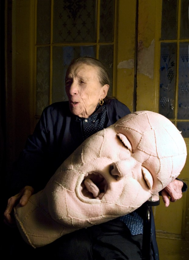 Louise Bourgeois with a fabric sculpture in progress in 2009 Photo © Alex Van Gelder Art © The Easton Foundation