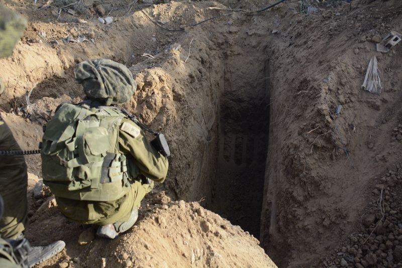 IDF soldier kneeling next to terror tunnels