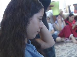Israeli Jews and Palestinian Arabs making friends at a co-existence workshop